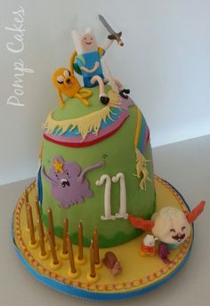The crazy guys from 'Adventure Time' Fondant figurines with Fin & Jake topper. Cake is dark choc mud with milk choc ganache.