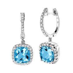Do you aim to make a lasting impression? This exceptional pair of cushion cut blue topaz and diamond drop earrings in white gold will leave a lasting impression on loved ones of all ages with their blissful and charismatic design. Give them to someone you love and adore for a special occasion, or tr