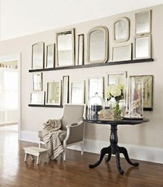 @Mimi Petroske another great way to bring groupings together, a thin plate rack style shelf can allow you to change things around too.