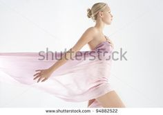 Beautiful young woman wearing a pink sarong around her body, pulling the fabric.