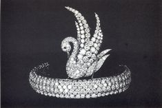 An unusual  art dceo bandeau, complete with diamond swan motif rising from a band of six rows of diamonds