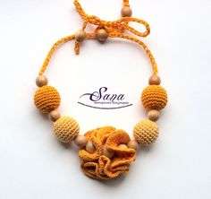 The nursing necklace is made with love for moms and their little ones. The crochet chain is threaded through the bead for adjustment and you do not need to tie a knot every time. Also, it can not untie and fall down from your neck. See the last photo to see how it looks. It is a really