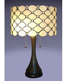 Tiffany style jeweled table lamp.  This would be great in one of my decor projects.  Tiffany look with a contemporary edge.
