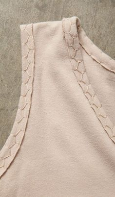 Excellent use of tone on tone detail embroidery. Simple to do, but gives the garment such a polished look.
