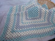 Light blue, gray and ivory baby blanket. This is a very special handmade crochet baby blanket.  This baby afghan will make a wonderful baby shower gift.  This blanket would make a lovely addition to your baby nursery decor. Perfect also, for travel, strollers, prams, cribs, tummy time and photo props