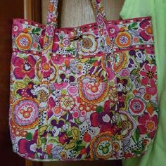 Disney Vera Bradley This is a beautiful bag/tote. I carried my laptop, iPad, files and normal work items. It is the XL Tote. I also have a blue one. Bags Totes