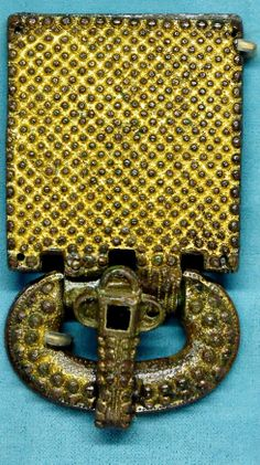 Visigothic belt buckle. Gilt, silvered bronze and glass paste, from Aquitaine, first half of the 6th century. Found in 1868 in the Visigothic necropolis of Tressan, Provence