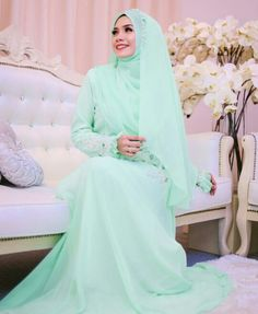 Mint green bridal outfit with hijab @adoria.my