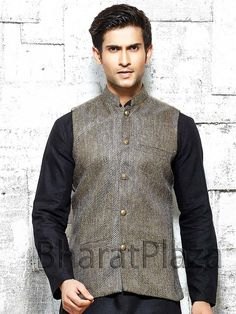 Miraculous dark beige color nehru jacket is planed on jute with high neck collar. Item Code: NJI4001BK