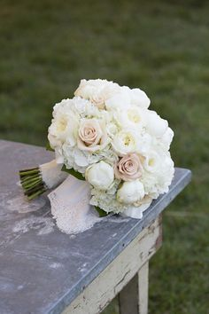 Crisp and Classic Bouquet - Sweet As Spring Wedding Flowers - Southernliving. This classic spring bouquet was composed of ivory patience garden roses, white peonies, white hydrangea, and Sahara roses. The bride's grandmother's handkerchief, edged in lace, was tucked inside.     SouthernWeddings.com: Charlotesville Wedding  Photo: Patricia Lyons  Florist: Southern Blooms