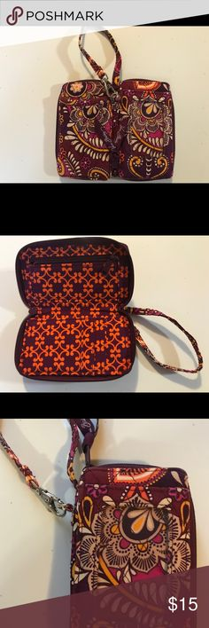 """Vera Bradley Wristlet Retired Pattern Safari Sunset July 2011-May 2012. 2x5 1/4, x 3/4. 6"""" wrist strap with clasp, interior zipper pocket, 3card slots,1 exterior slip, ID window, tiny bit of wear on one corner as pictured  otherwise excellent condition. Please review all pictures prior to purchase   If you have questions I'm happy to respond!! All Vera purchases are recorded in order to ensure a fair and equitable transaction for the buyer and seller.  Vera Bradley Accessories Watches"""