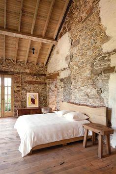Contemporary Master Bedroom with Hardwood floors, Exposed beam, Standard height, flush light, French doors, interior brick
