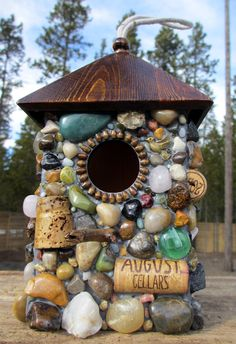 Birdhouse with Wine Corks and Rocks-a very fun way to use your wine corks & fun treasures picked up from your travels.
