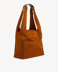 """Soft calf suede unlined shopper tote 100% Calf suede with cow leather handle grip, unlined Height 13"""", Width 13.5"""", Depth 6"""", Interior hanging pouch pocket for your essentials Drop Length: 10.5"""" CN 100% CALF SUEDE / 100% COW LEATHER Imported"""