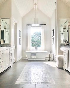 Bathroom goals from my girl 👏🏻👏🏻👏🏻 From the large soaker tub to the tile work and vaulted shiplap ceilings featuring the aged brass sweeny chandelier is perfection. Master Bathroom Layout, Luxury Master Bathrooms, Large Bathrooms, Dream Bathrooms, Modern Bathroom, Bathroom Goals, Bathroom Ideas, Mansion Bathrooms, Bathroom Organization