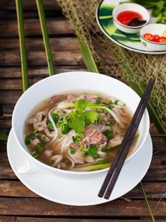 "Did you know that pho (pronounced like ""fun"" without the ""n"") originated in the early century in northern Vietnam? Warm up with Viking River Cruises traditional beef pho recipe. Asian Recipes, Beef Recipes, Soup Recipes, Cooking Recipes, Ethnic Recipes, Healthy Menu, Healthy Eating Tips, Healthy Recipes, Pho Vietnam"