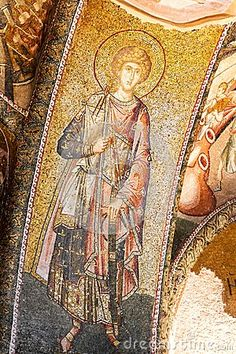 Wall mosaics of ancient Chora Church, Istanbul. Byzantine military saint in rich dresses. 14th Century, Constantinople