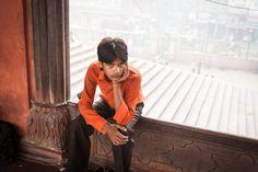 Boy sitting in a window in Delhi, India #streetphotography #streetphotographer #India #travel #travelphotographer #travelphotos