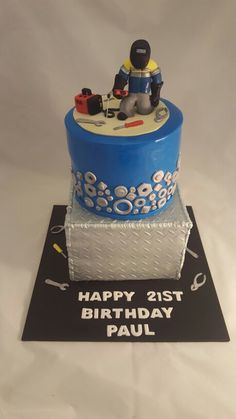 Paul (the welder's) 21st Birthday cake! a two tiered vanilla buttacake with…