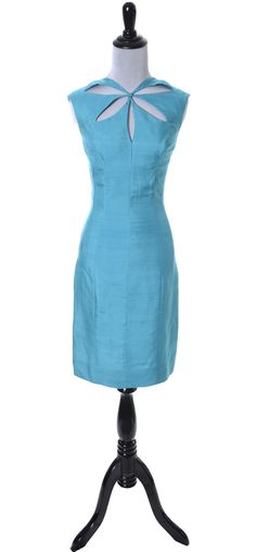 1960's Luis Estevez vintage designer dress in blue silk with cut out keyhole bodice