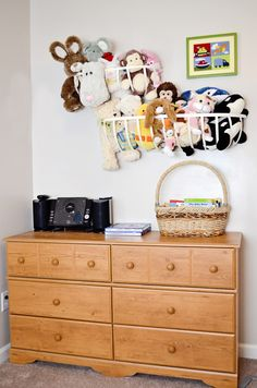 These Stuffed Animal Toy Storage Baskets are a creative and fun way to store your children's stuffed animals. Perfect for small spaces, it gets all of the toys off of beds and the floor.