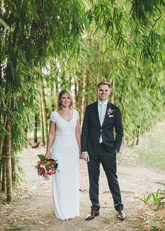 Bride wears THEIA Lilia gown