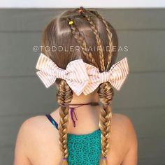 Yesterday's style stayed in so well, I was able to reuse the topsy tails and braids! I switched it up a bit by adding pigtails with small sections of fishtails, then finished with braids! Adorable bows from @littleloveleighs!!