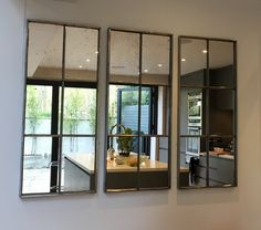 Trio of architectural mirror panels ...