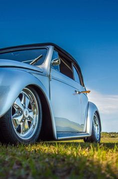 Brian Witt, Lake Wales, Florida. 1960 Polar Silver VW Euro Convertible, sitting on 16″ fuchs on rear, 15s on front. 2180cc engine with a Rancho Tranny.