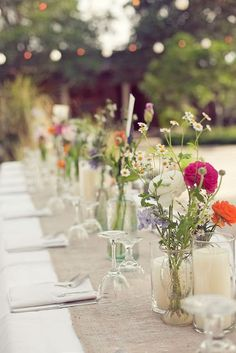 wildflower table with burlap runner (maybe add lace?)