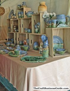 Lots of craft display booth photos, tips and tools for creating your own display. Love the crate idea! Stall Display, Vendor Displays, Craft Booth Displays, Display Ideas, Booth Ideas, Vendor Booth, Pottery Booth Display, Market Displays, Jewelry Displays
