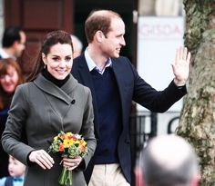 Prince William, Duke of Cambridge and Catherine, Duchess of Cambridge smile as they visit Caernarfon on November 20, 2015 in Wales