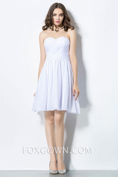 white strapless sweetheart ruched bodice empire knee length bridesmaid dress. Comes in fuchsia.