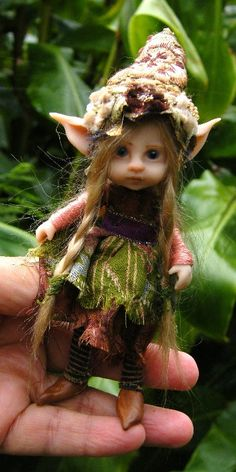 Sweet Posable pixie fairy is an ooak polymer (cooked to ensure durability) sculpted over a strong wire armature dressed in stripey pixie