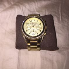 MICHAEL MICHAEL KORS GOLD WATCH Excellent condition. Minor scratches. Comes with box and extra links that came with it. MICHAEL Michael Kors Jewelry