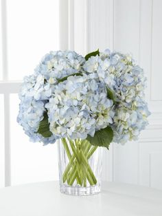blue, white and yellow flower arrangements | blue hydrangea arrangement in a unique glass vase - Joyful ...