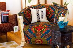 A vintage Bohemian-style barrel chair sits boldly with primary colors. Notice the tie that trims the throw pillow on the chair.
