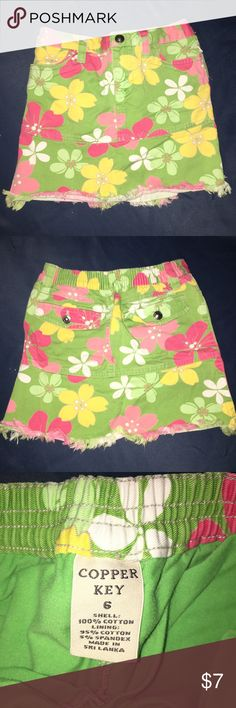 Floral Skirt -- Cute floral skirt with short at the bottom.  -- stretch band at the back. -- no stains . Copper Key Bottoms Skirts