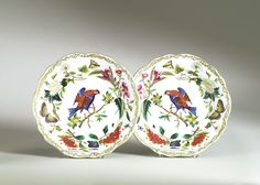 This set of porcelain chargers features vibrantly-colored birds and beautifully…