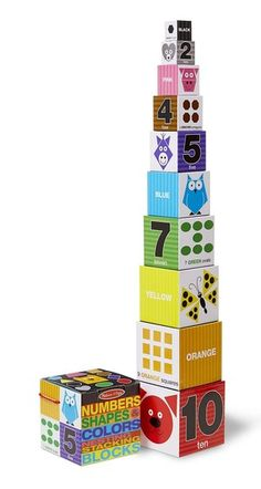 Nesting & Stacking Blocks - Numbers, Shapes, Colors: Brightly colored animals illustrate numbers, shapes, and colors on these sturdy cardboard blocks. Nested, the 10 blocks fit into the durable case, which features convenient carrying handles. Stacked, the blocks form a tower nearly 3 feet high!