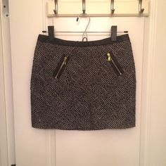 Express Tweed Mini Skirt Beautiful, never-been-worn and new with tags, Express skirt. It's a darker tweed with gold-colored accent zippers. I've kept it in my closet for a while, so it is in excellent condition. I would keep it, but it no longer meshes into my daily wardrobe. Express Skirts Mini