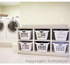 Laundry Room. I love the individual laundry baskets, helps to remove the clutter.