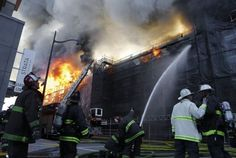 San Francisco firefighters battle a five alarm fire in the Mission Bay area of San Francisco, Calif. on Tuesday March 11, 2014. Photo: Michael Macor, The Chronicle