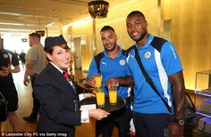 Danny Simpson (centre) and captain Wes Morgan enjoyed a glass of orange juice as they waited to fly