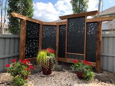 Create a perfect accent wall in your rock garden using black privacy screens. The screens and cedar framing contrast beautifully against the plants and rocks. Love the creativity in this design! Privacy Wall On Deck, Backyard Privacy Screen, Privacy Fence Designs, Privacy Screen Outdoor, Outdoor Pergola, Deck Privacy Screens, Privacy Fences, Fencing, Diy Fence