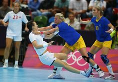 Norway's Kristine Lunde-Borgersen (L) collides with Sweden's Johanna Ahlm in their women's handball Preliminaries Group B match at the Copper Box venue during the London 2012 Olympic Games July 30, 2012.