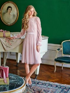 Victorian Dress 12/2015 This beautiful dress is made using an embroidered tulle fabric and is gathered at the front and back and held with a wide grosgrain ribbon. The long sleeve cuffs are also cinched with the same ribbon. Perfect for the girly girls!