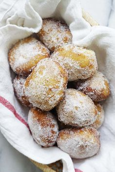 Easy and quick malasadas Portuguese donuts coated with granulated sugar. Köstliche Desserts, Delicious Desserts, Dessert Recipes, Yummy Food, Hawaii Desserts, Bakery Recipes, Donut Recipes, Cooking Recipes, Budget Recipes