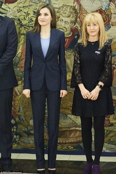 The always elegant Queen Letizia opted for a pared back trouser suit with a simple, round necked jumper worn underneath