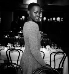 """""""I chose this dress because it's simple and cozy.""""  Lupita attended a Dinner hosted by Vogue's Sally Singer for fashion label Sacai's Chitose Abe, 23rd Oct 2013.  Dress: Sacai fitted sweaterdress  Photographer: Pablo Frisk — in New York, New York."""